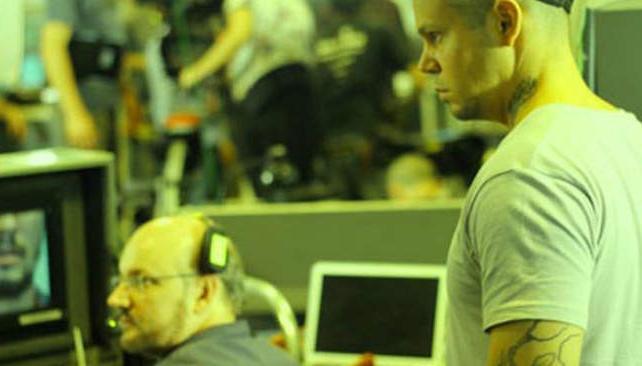 En acción. Campanella y el cantante de Calle 13.